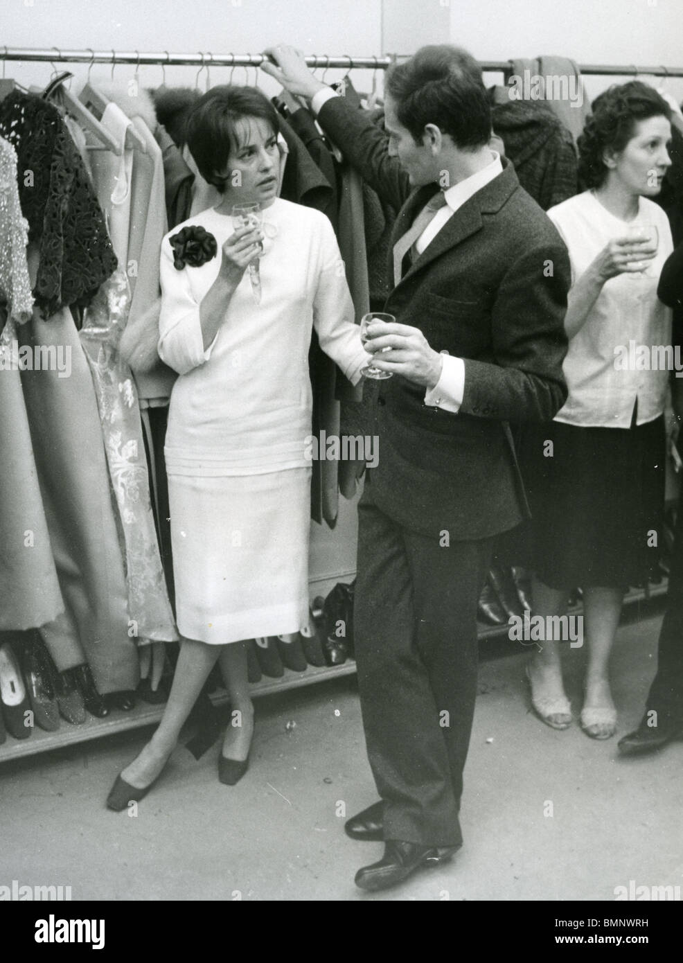 PIERRE CARDIN - French fashion designer at his Paris salon with French actress Jeanne Moreau about 1970 - Stock Image