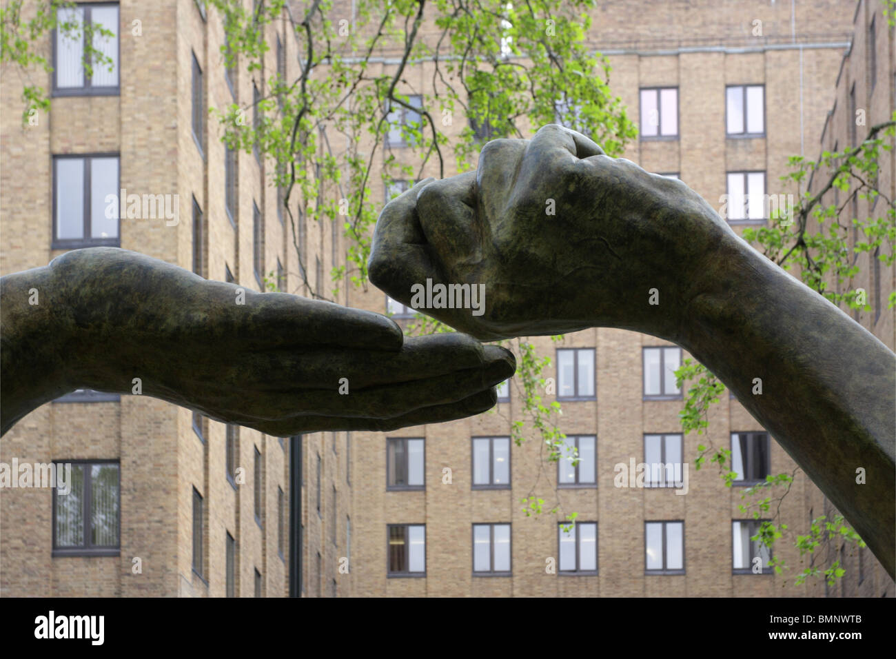 Sited on the east side of Berkley Square in London was Lorenzo Quinn`s sculpture `Give and Take`, yet another fine Stock Photo