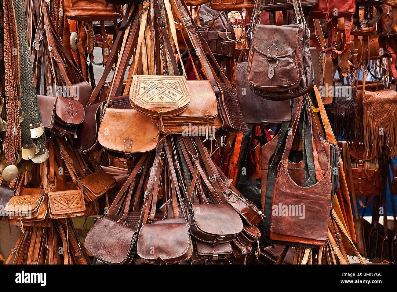 Leather goods for sale in an outdoor market, Madrid, Spain - Stock Image