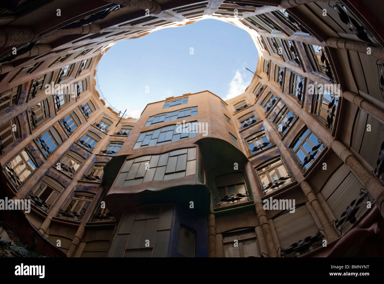 Casa Mila viewed looking up the interior of the apartment block - Stock Image