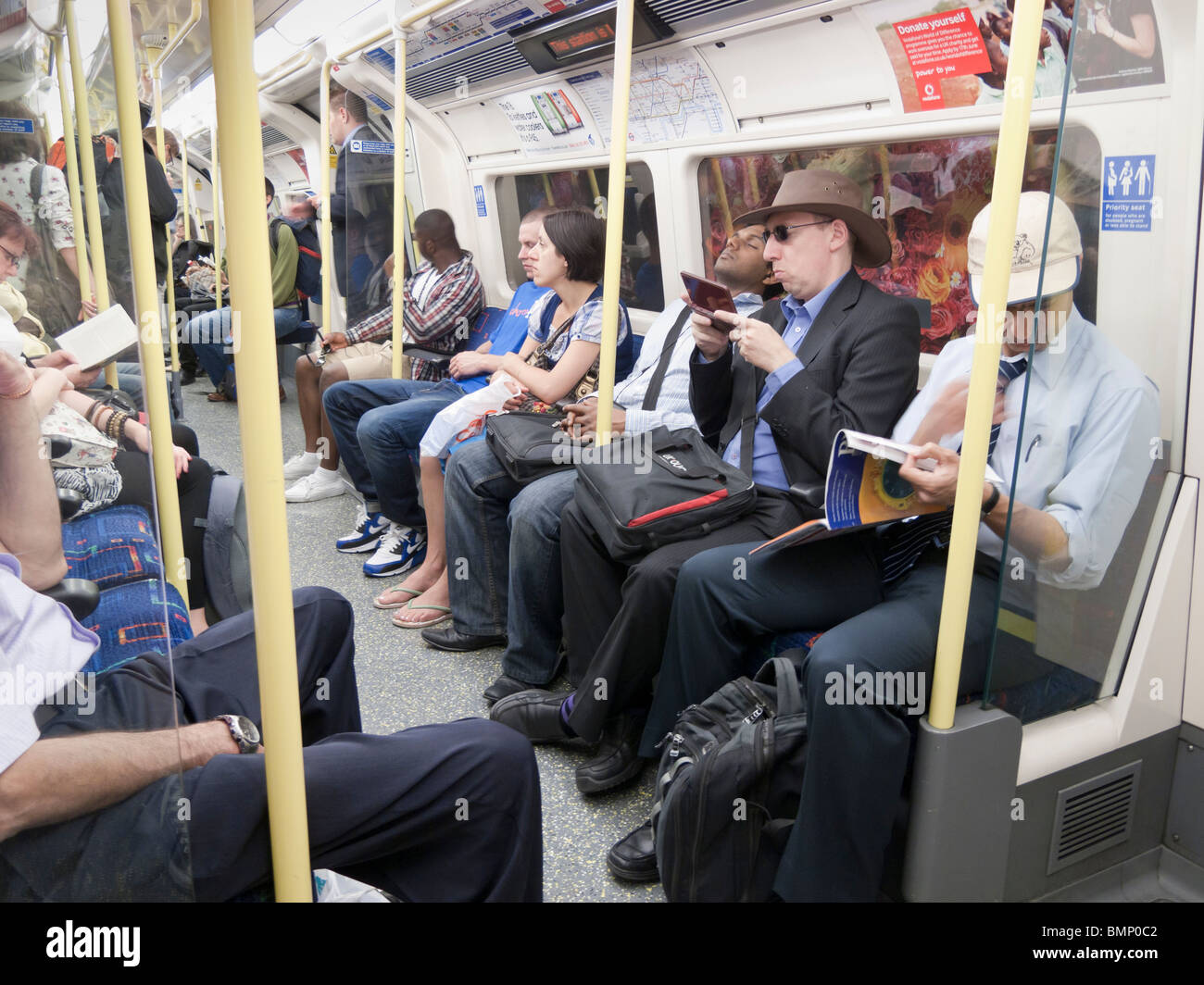 People on the London underground train,London,UK - Stock Image