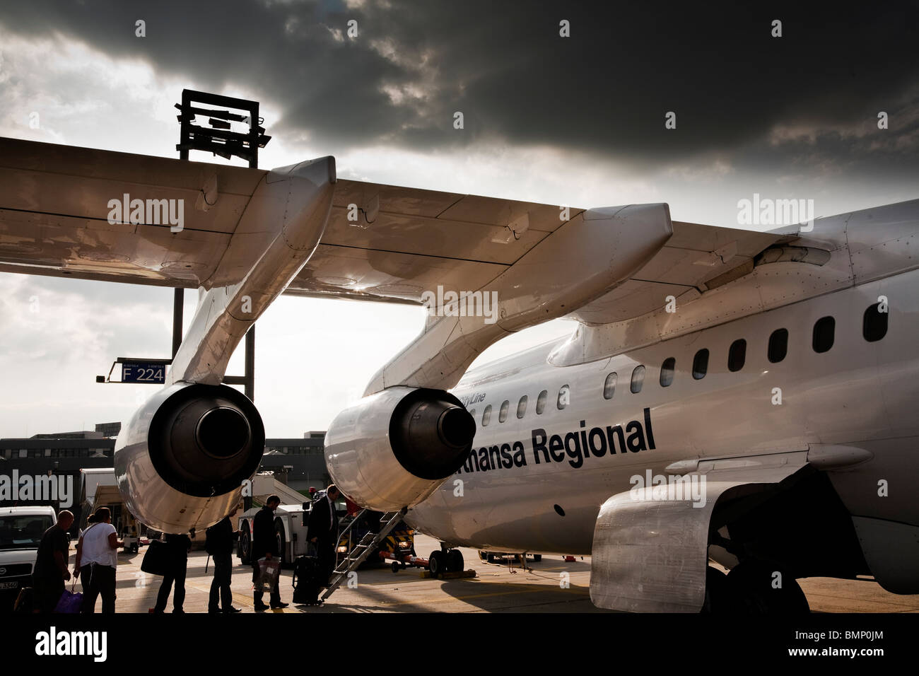 Passenger embark onto a Lufthansa Regional Airliner at Frankfurt International Airport - Stock Image