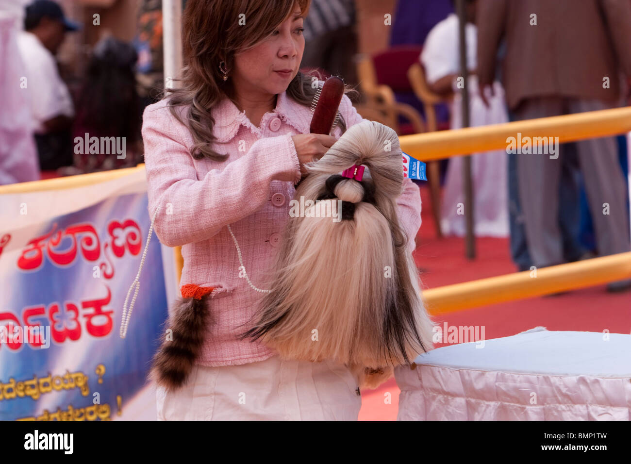 A lady with her Shih Tzu dog at a dog show in Bangalore. - Stock Image