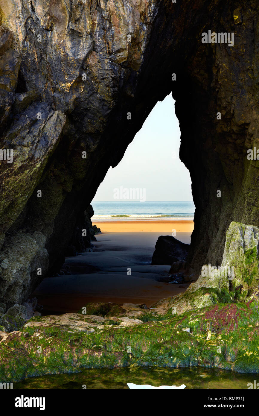 Cave passage on Three Cliffs Bay, Gower peninsula, South West Wales. Sea arch - Stock Image