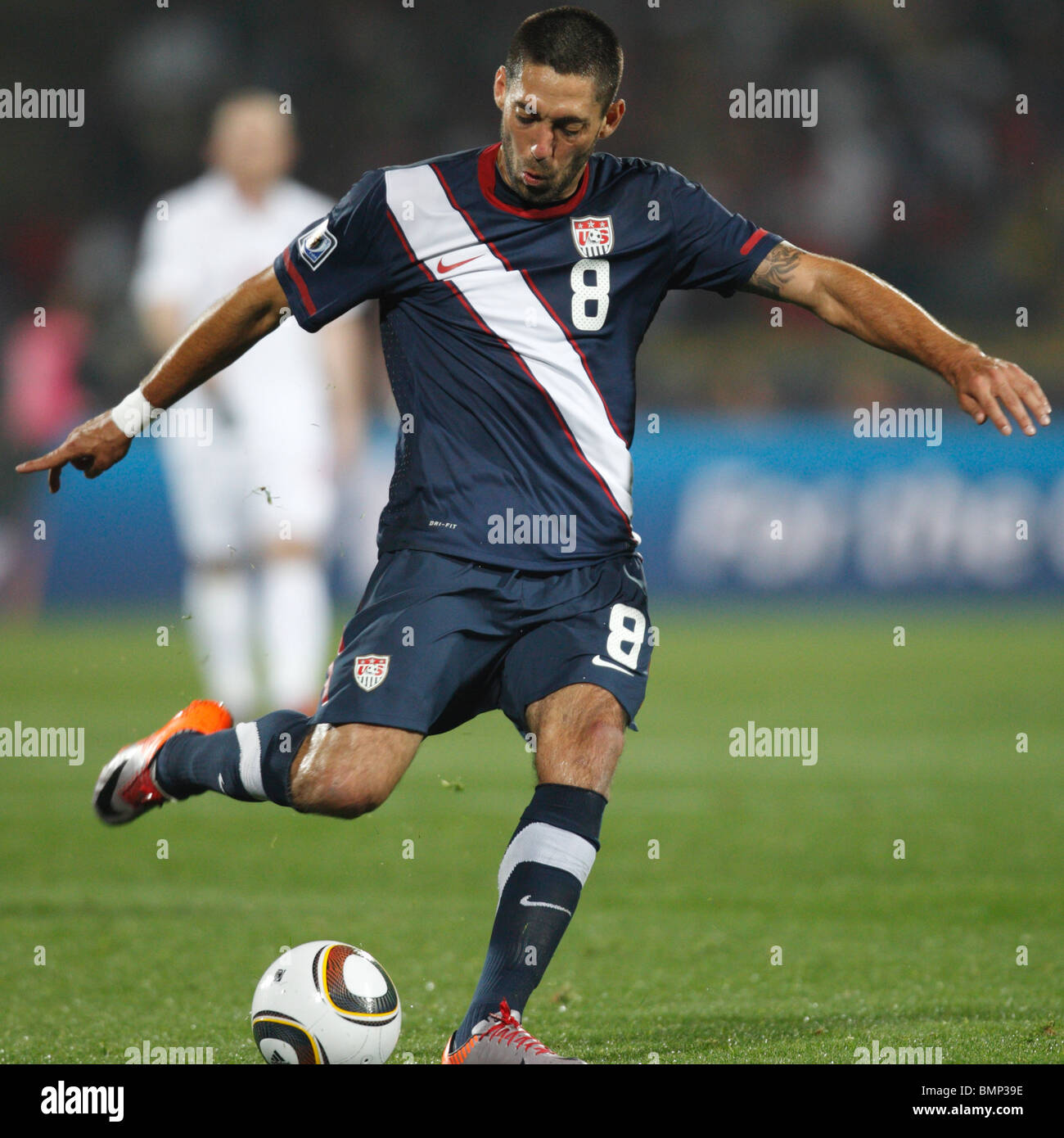 Clint Dempsey of the United States sets to kick the ball during a 2010 FIFA World Cup football match against England. - Stock Image