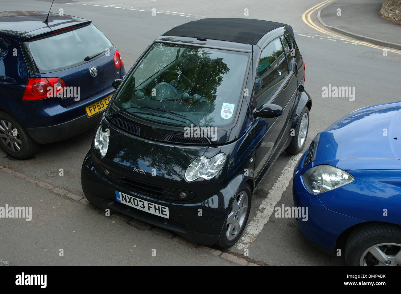 Smart car parked sideways, Oakham, Rutland, England, UK - Stock Image