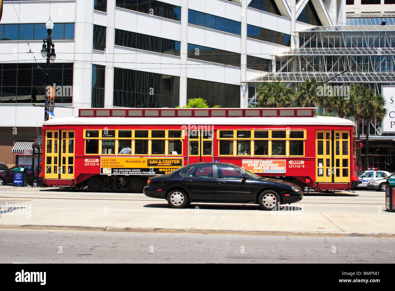 A private car and public transportation ; canal street ; New Orleans ; Louisiana ; U.S.A. United States of America Stock Photo
