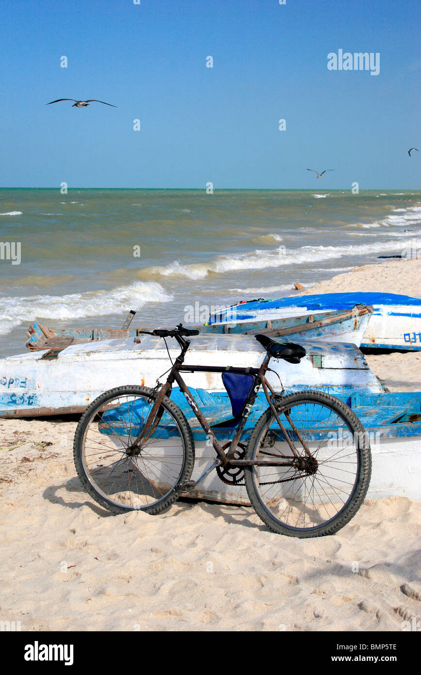 Bicycle parked at beach ; Progresso ; Mexico - Stock Image