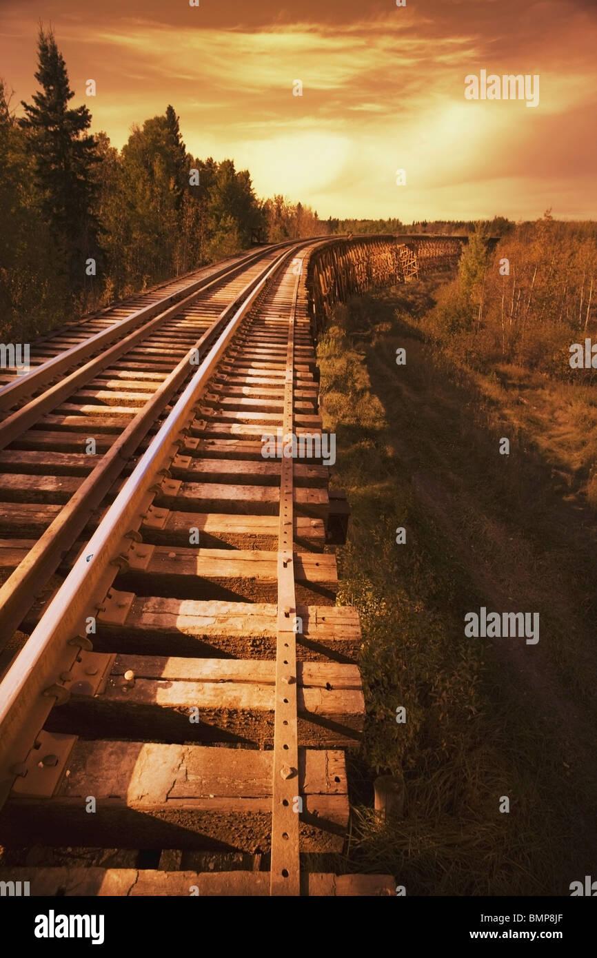 Alberta, Canada; Train Trestle At Sunset - Stock Image