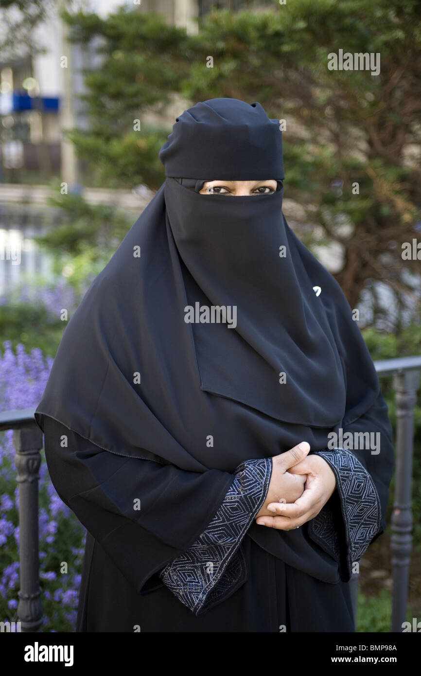 Portrait of a professional Muslim woman living in New York City. She teaches college level nursing courses fully - Stock Image