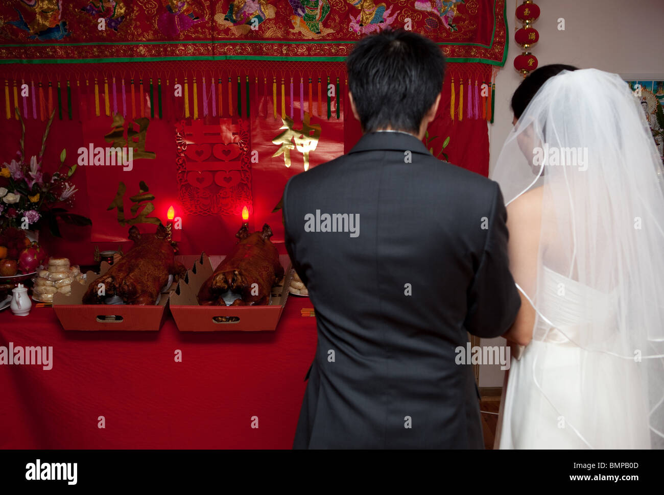 Asian Bride And Groom Giving Thanks For Gifts On Wedding Day Stock