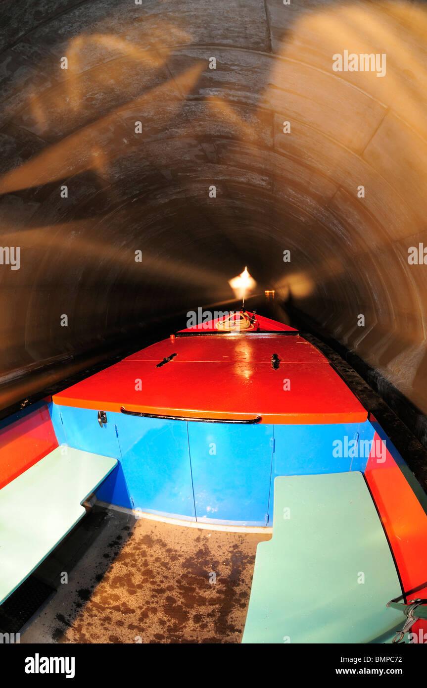 Navigating Blisworth Tunnel, Grand Union Canal, UK - Stock Image