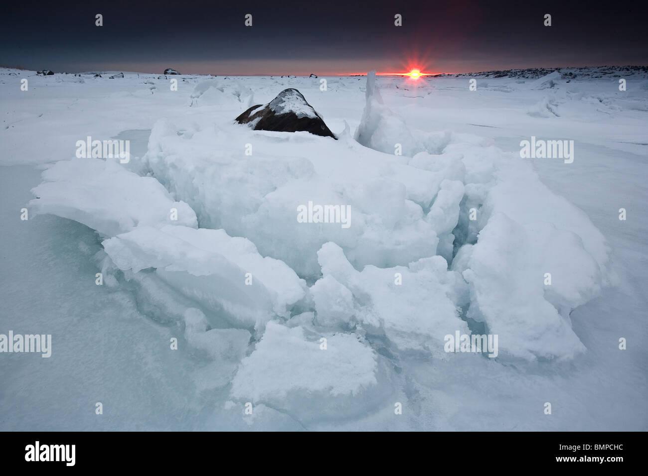 Ice formations and sundown at Larkollen in Rygge kommune, Østfold fylke, Norway. - Stock Image