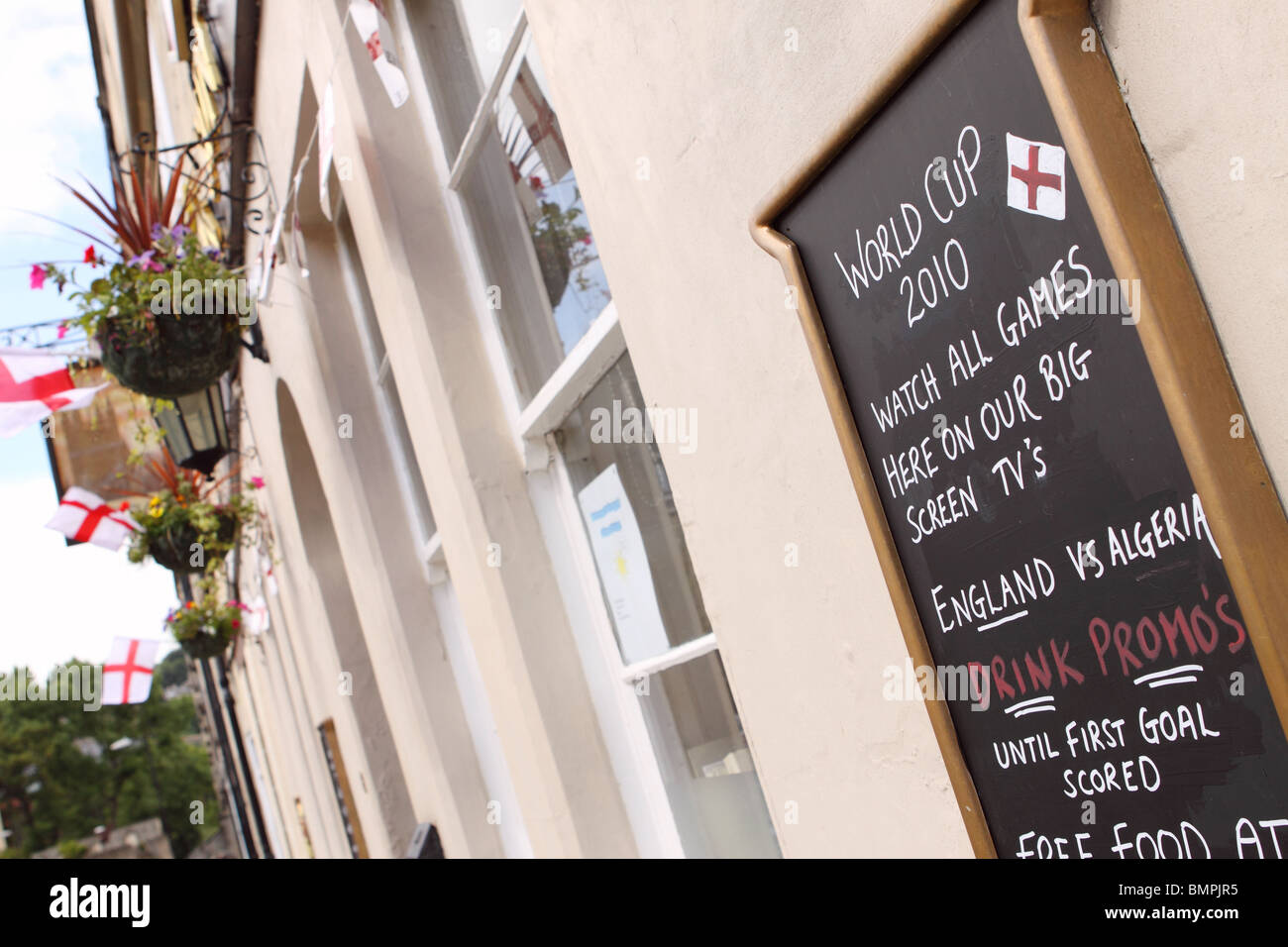 World Cup 2010 pub in Bath England advertising England football games on large screen TV - Stock Image