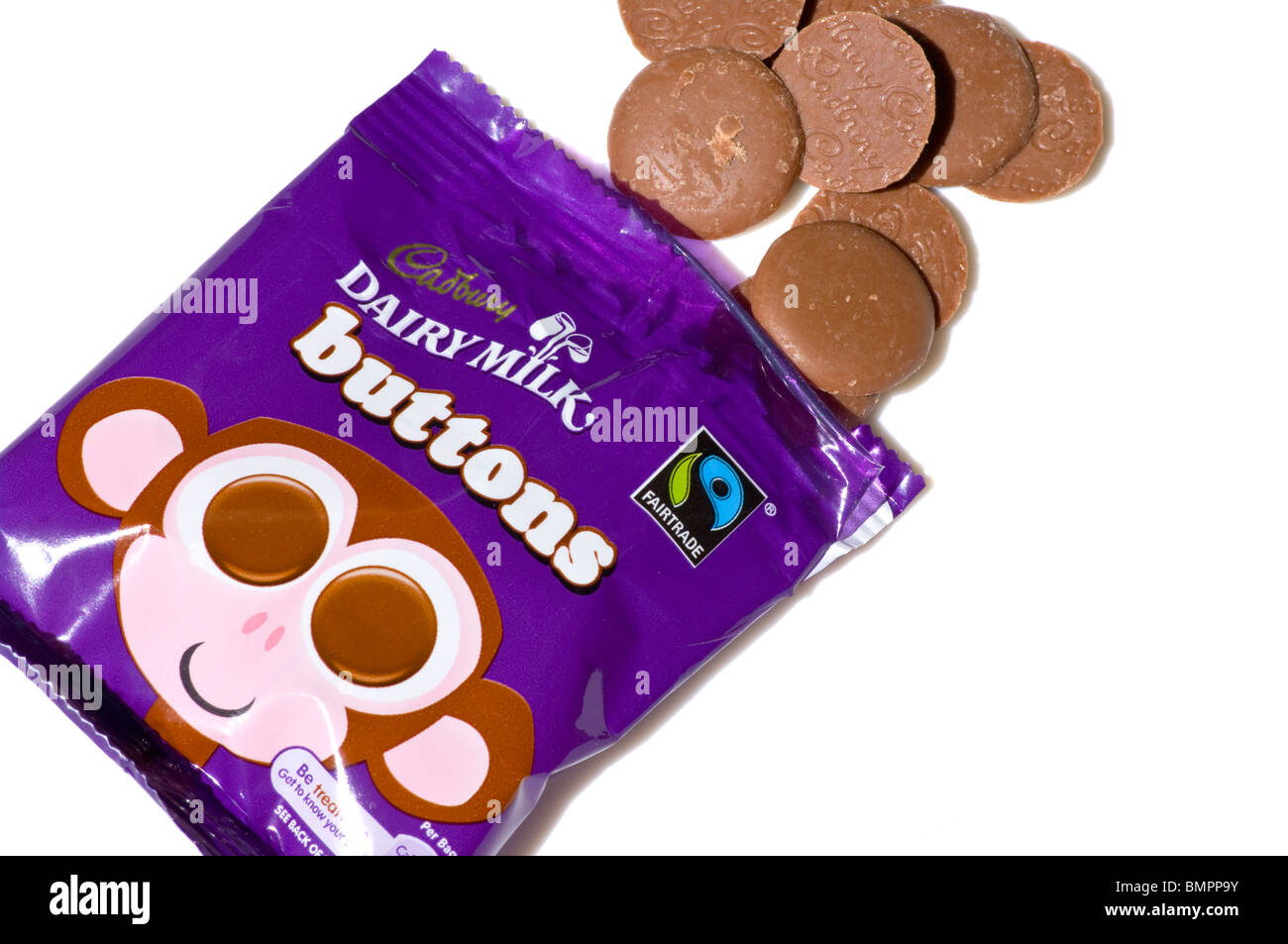 Bag Of Cadbury Dairy Milk Chocolate Buttons Isolated Against