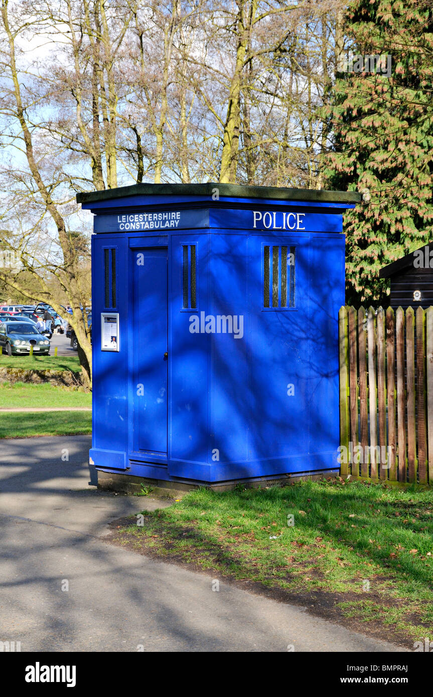 Blue police telephone box in rural England. - Stock Image