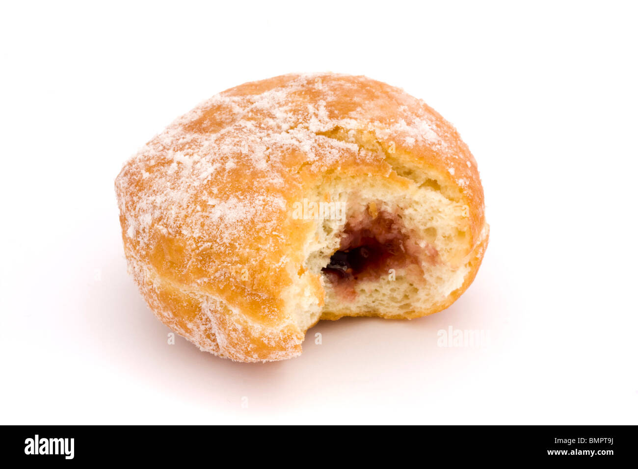 jam doughnut with a bite missing on a white background - Stock Image