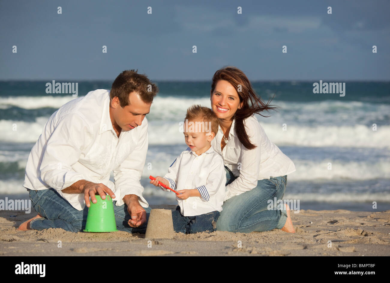 Fort Lauderdale, Florida, United States Of America; A Family Playing In The Sand On The Beach - Stock Image