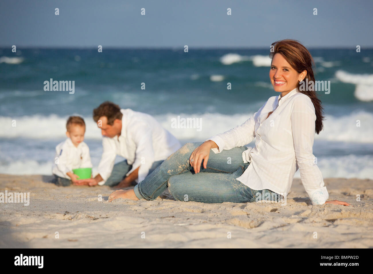 Fort Lauderdale, Florida, United States Of America; A Woman On The Beach With Her Family Stock Photo