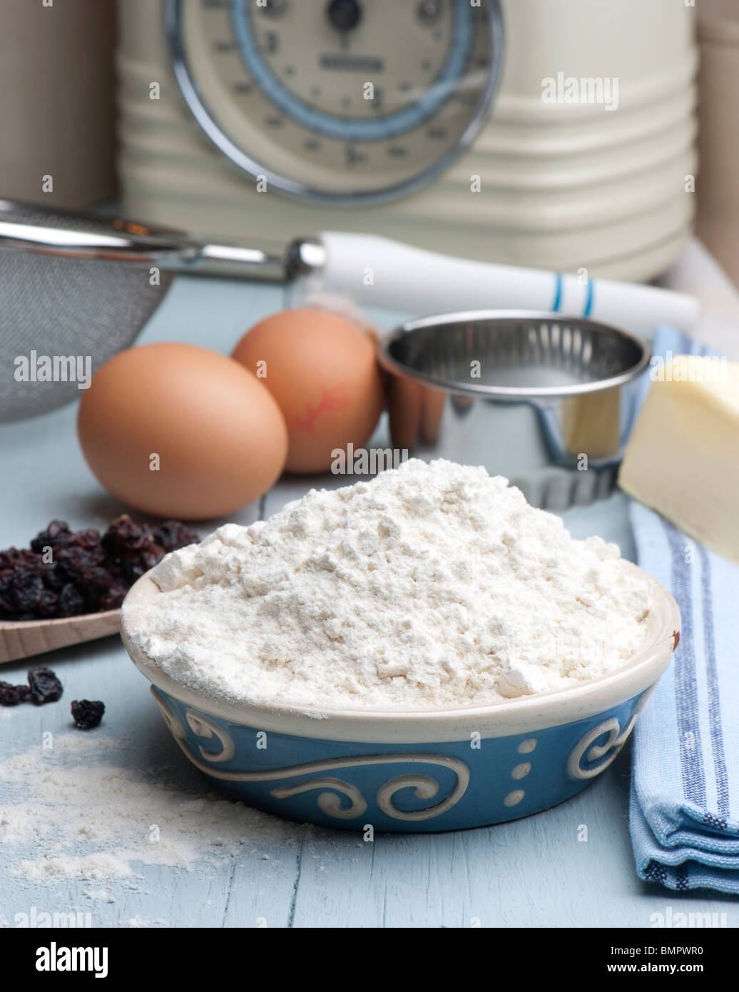 Ingredients Set Out For Making Scones, Flour, Butter, Eggs and Currants - Stock Image
