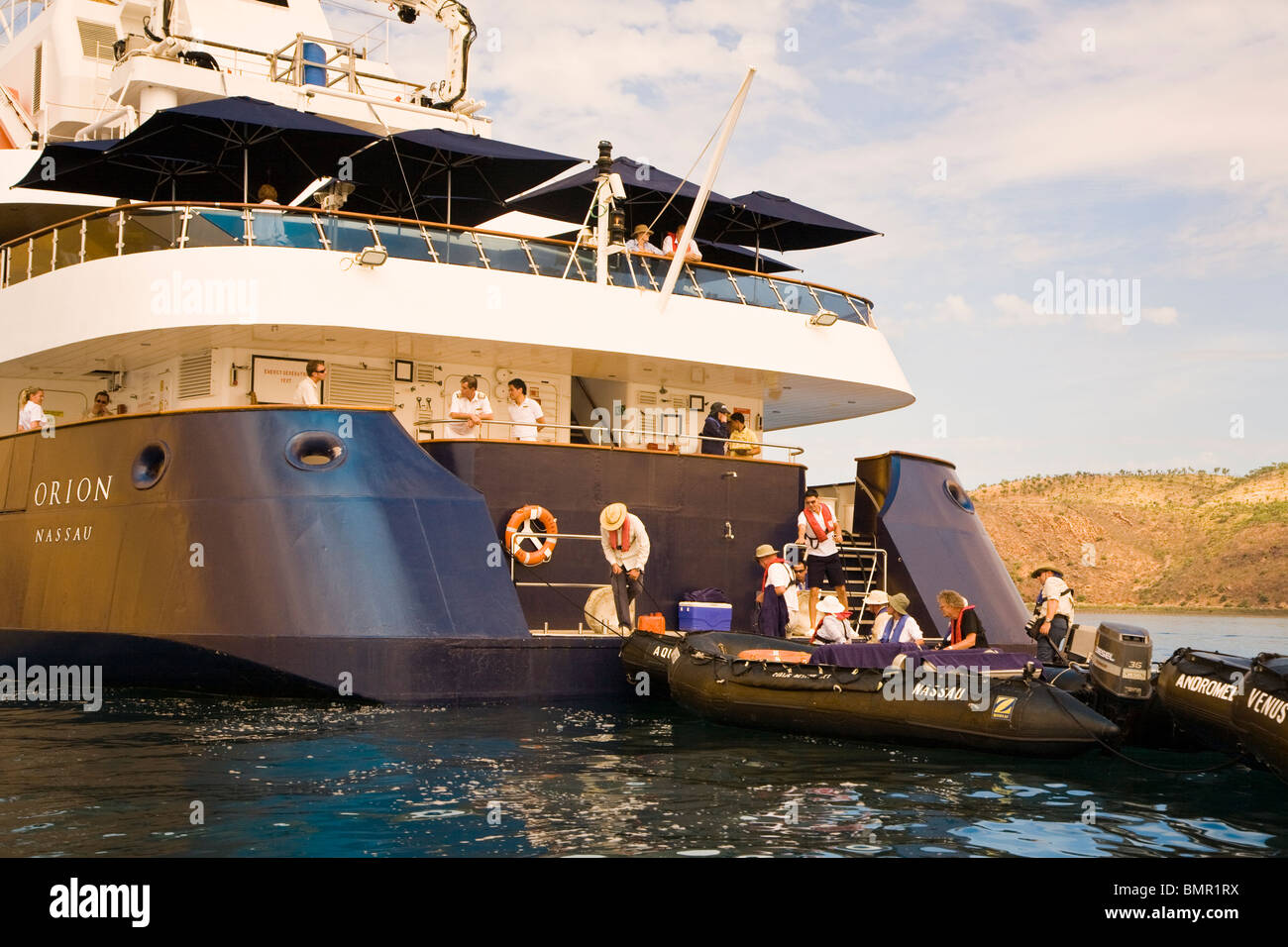 Excusion Zodiacs embark/disembark from a convenient platform on the lower rear deck of the Aussie expedition vessel - Stock Image