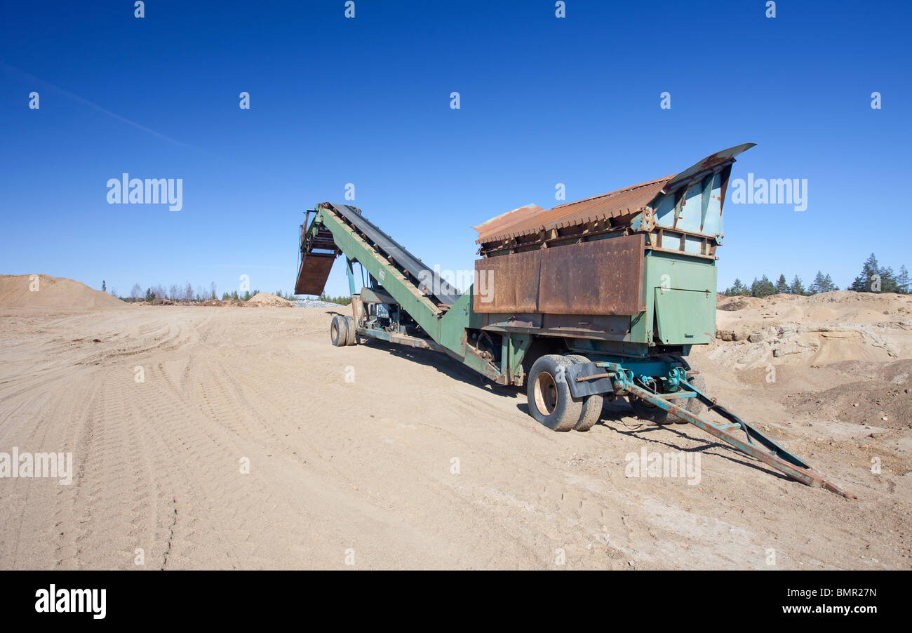 Movable conveyor belt and screening device for moving gravel and sand on a Finnish gravel pit , Finland - Stock Image