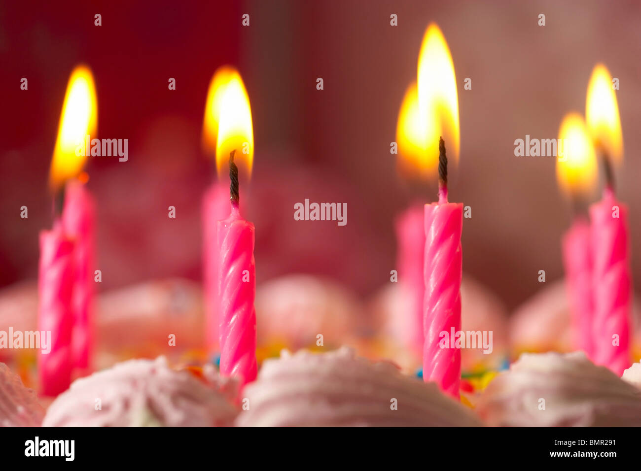 Knoxville, Tennessee, United States Of America; Candles Lit On A Birthday Cake - Stock Image