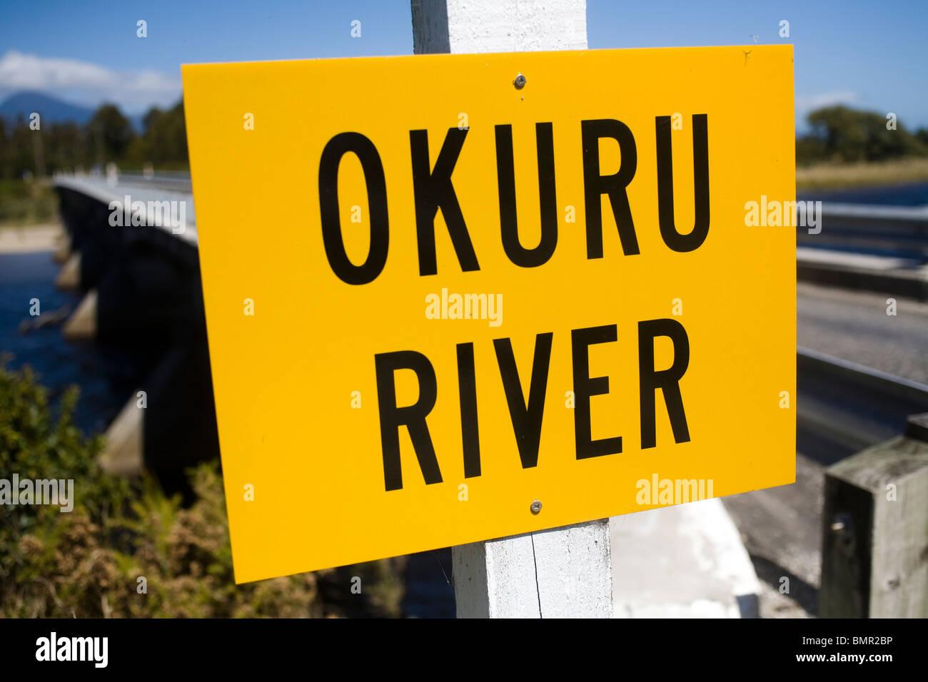 Bridge over the Okuru river, Westland, New Zealand, South Island. - Stock Image