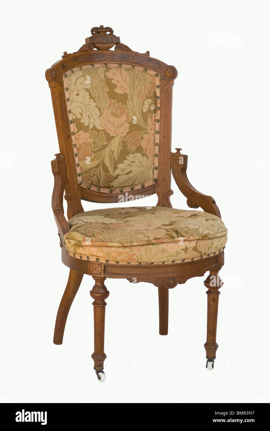 Eastlake Victorian period chair carved wood & upholstered. Front view isolated. - Stock Image