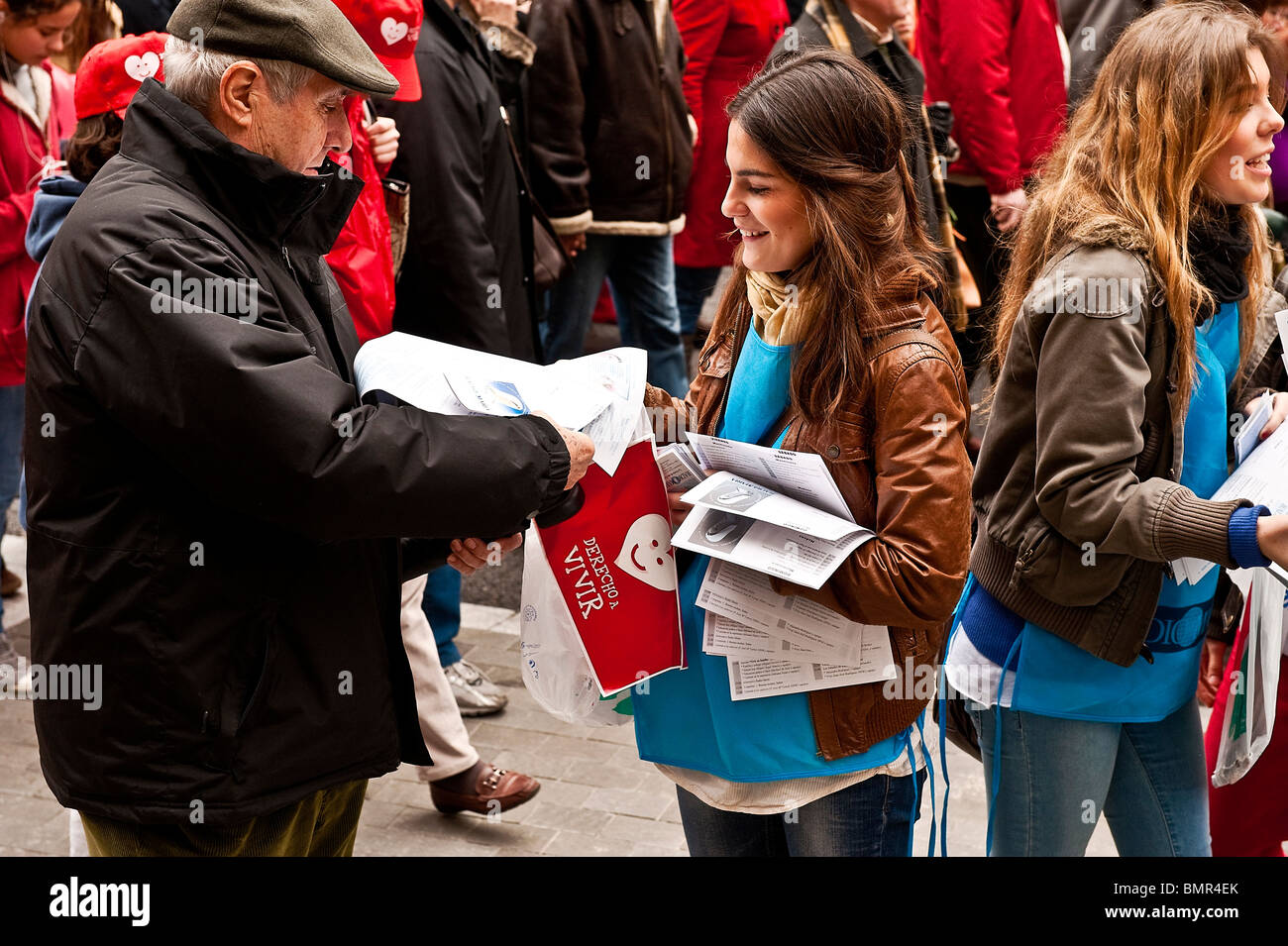 Young pro-life women hand out leaflets at a huge 'March for Life' demonstration, March 7th, Madrid, Spain - Stock Image