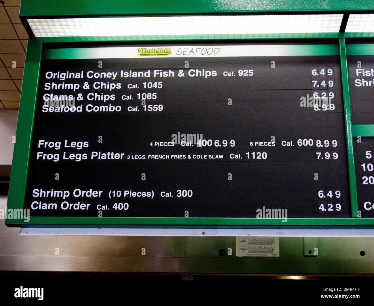 A menu sign at Nathan's restaurant at the famous Coney Island amusement park in Brooklyn, New York, lists a - Stock Image