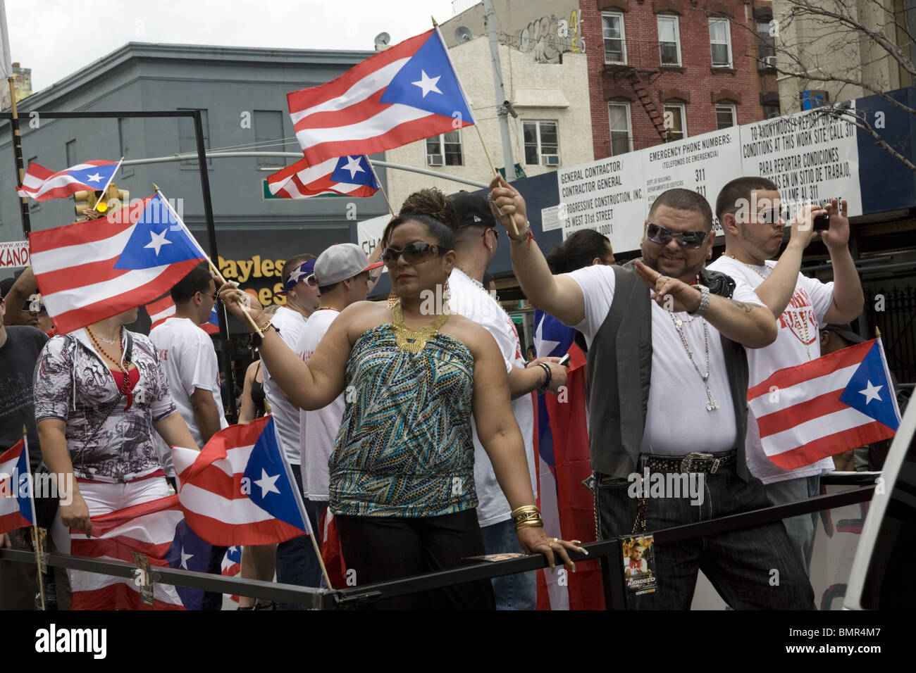 Proud Puerto Ricans on float at the Puerto Rican Parade in Brooklyn, NY. - Stock Image