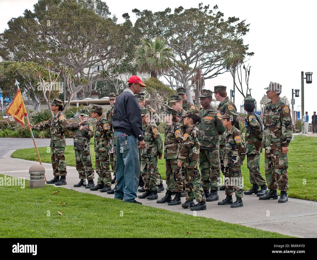"Interracial Young Marines wearing the ""Wood Pattern"" Battle Dress Uniform in formation in Laguna Beach, California. Stock Photo"