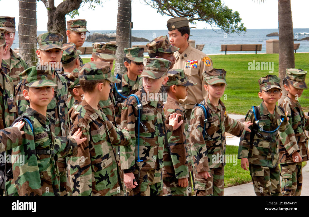 """Interracial uniformed Young Marines """"dress right"""" in formation in Laguna Beach, California. Stock Photo"""