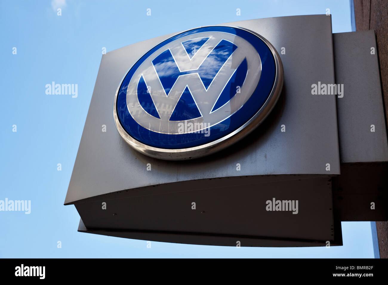 VW logo outside Volkswagen dealership London, UK - Stock Image