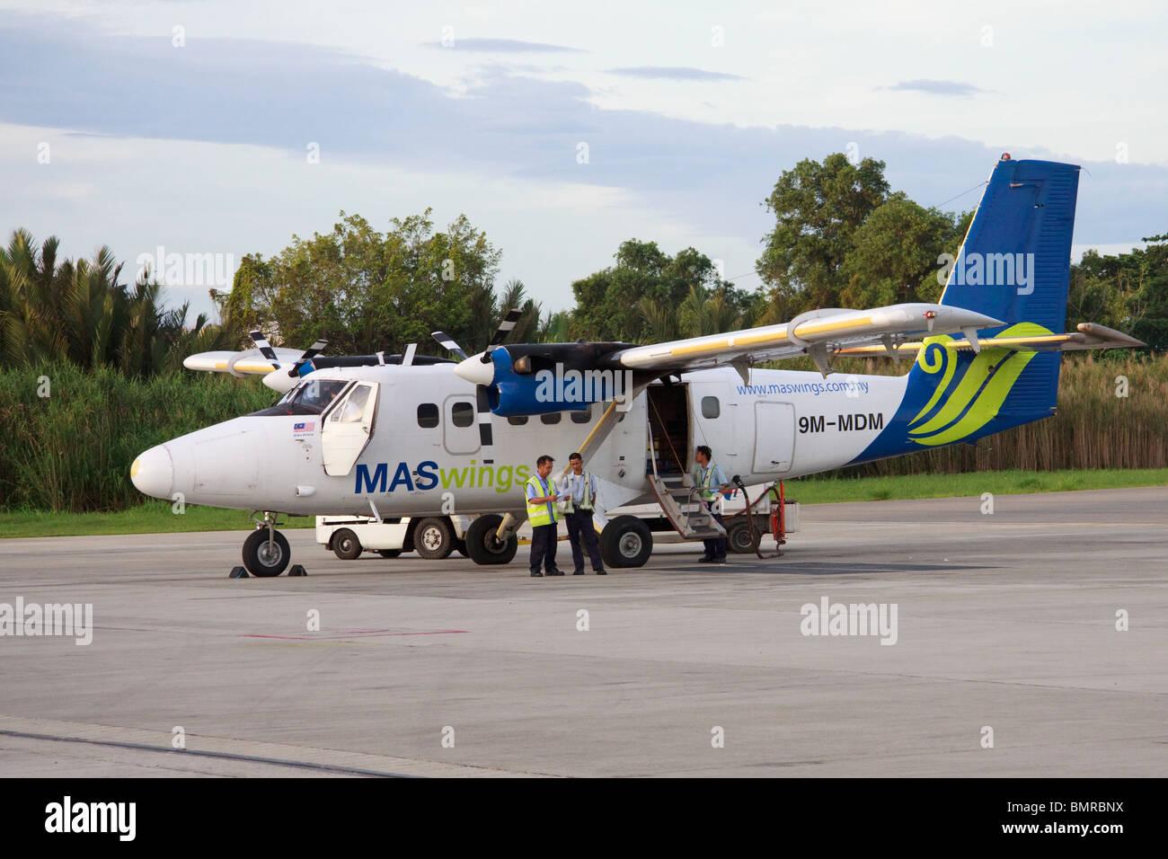 MAS wings aircraft, Kota Kinabalu airport, Malaysia - Stock Image
