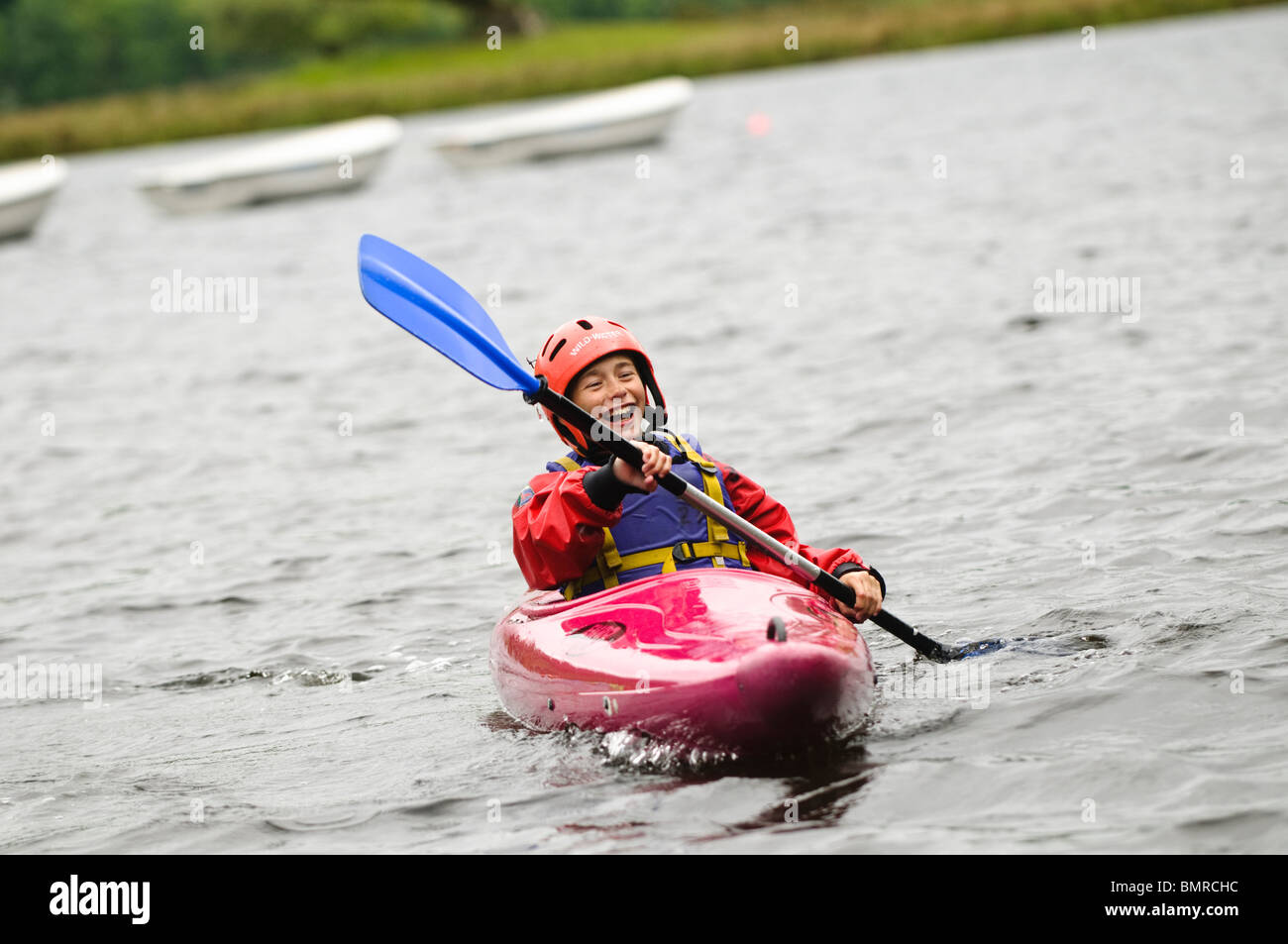 A boy Kayaking on Lake as part of a course organised by Canolfan Yr Urdd outward bound adventure centre Glanllyn - Stock Image