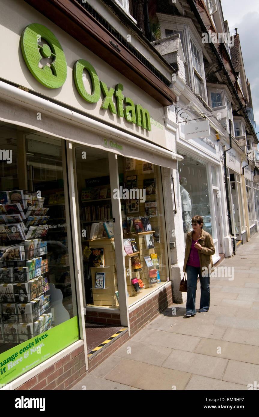 oxfam charity charities shop shops vacant empty high street premises retail retailer raising money - Stock Image