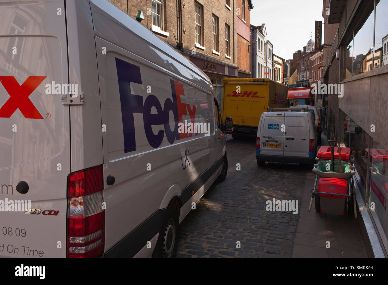Courier delivery vans blocking the street in Norwich , Norfolk , England , Great Britain , Uk - Stock Image