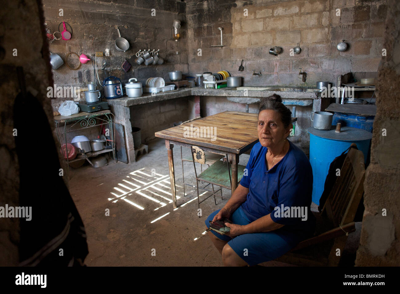 Cuban Woman In Her Kitchen   Stock Image