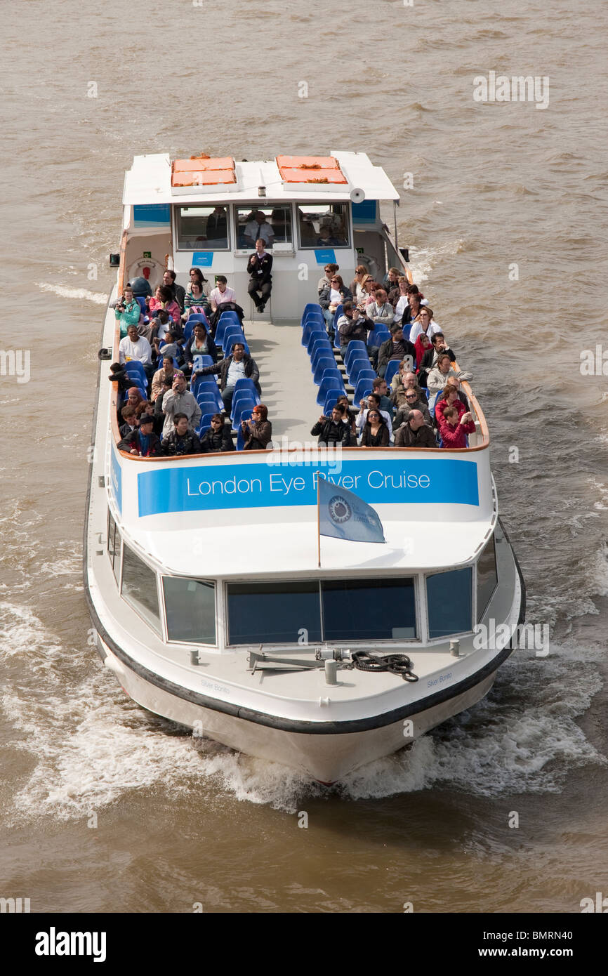 Sightseers on a boat trip on the River Thames - Stock Image