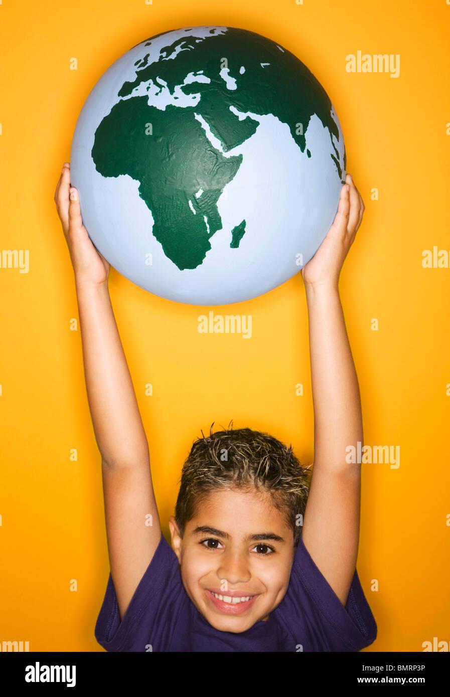 A Boy Holding A Globe - Stock Image