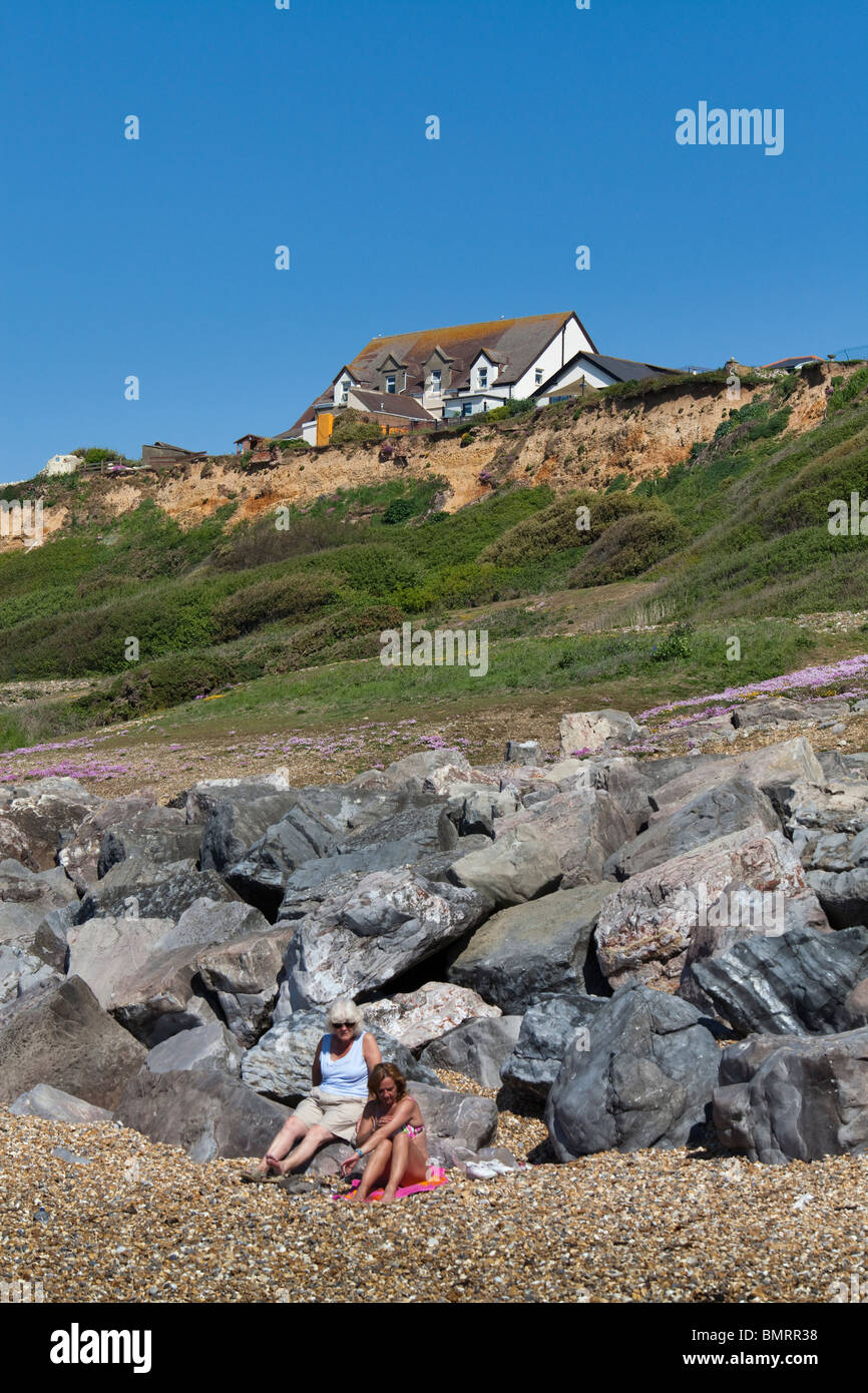 buildings on the cliff edge at Barton on Sea in Hampshire in danger of falling into the sea due to costal erosion Stock Photo