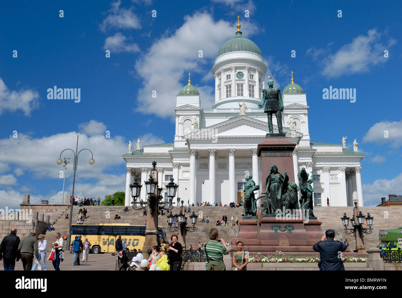 Tourists are taking photos in the front of Helsinki's sights at the Senate square. Senaatintori, Senate square, - Stock Image