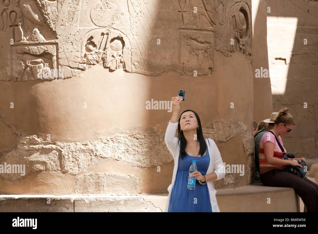 Tourists taking photos  in Karnak Temple, Luxor, Egypt Stock Photo