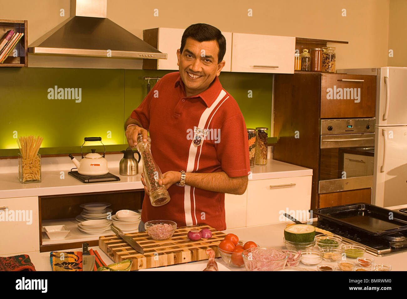 Sanjeev Kapoor one of the top chefs in the world preparing food NO ...
