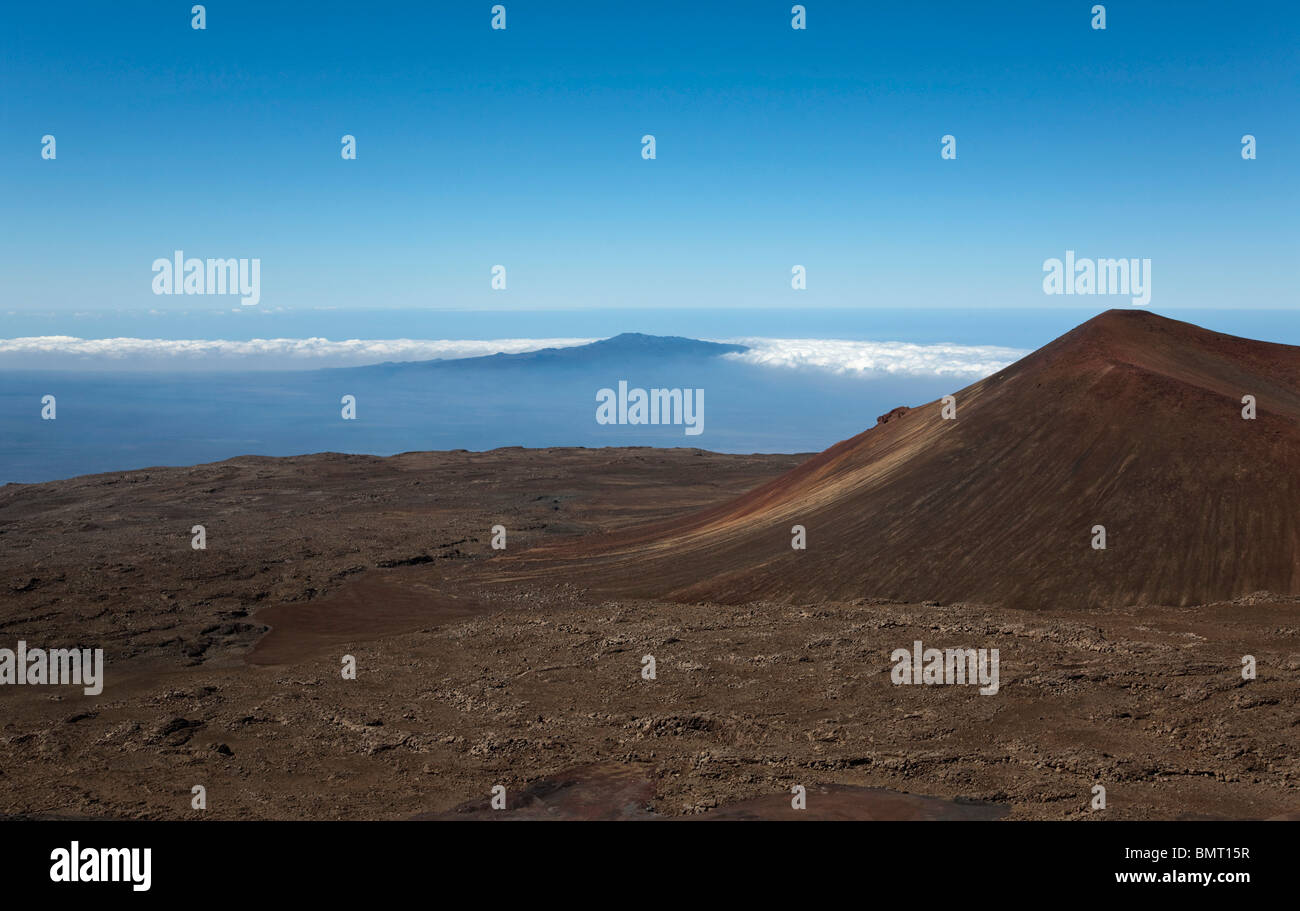 Hawaii, United States Of America; Volcanic Cone On Mauna Kea In The Foreground With A Distant View Of Mauna Loa - Stock Image