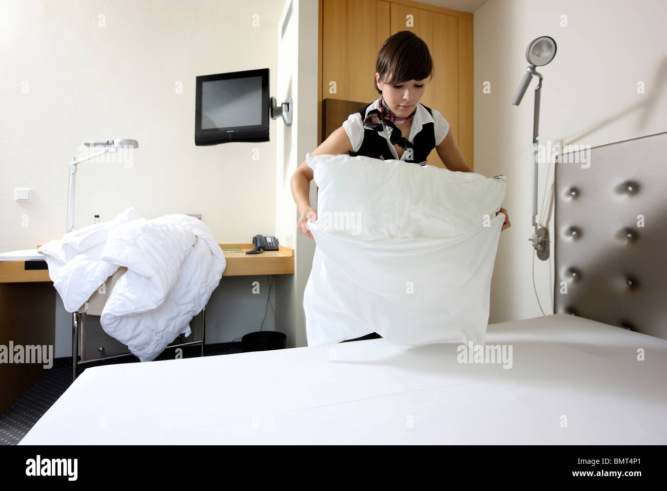 Hotel, room service, house keeping at work in a hotel room. Cleaning ...