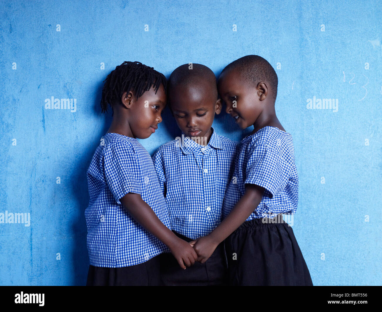 Three African children holding hands after the Rwandan genocide. - Stock Image