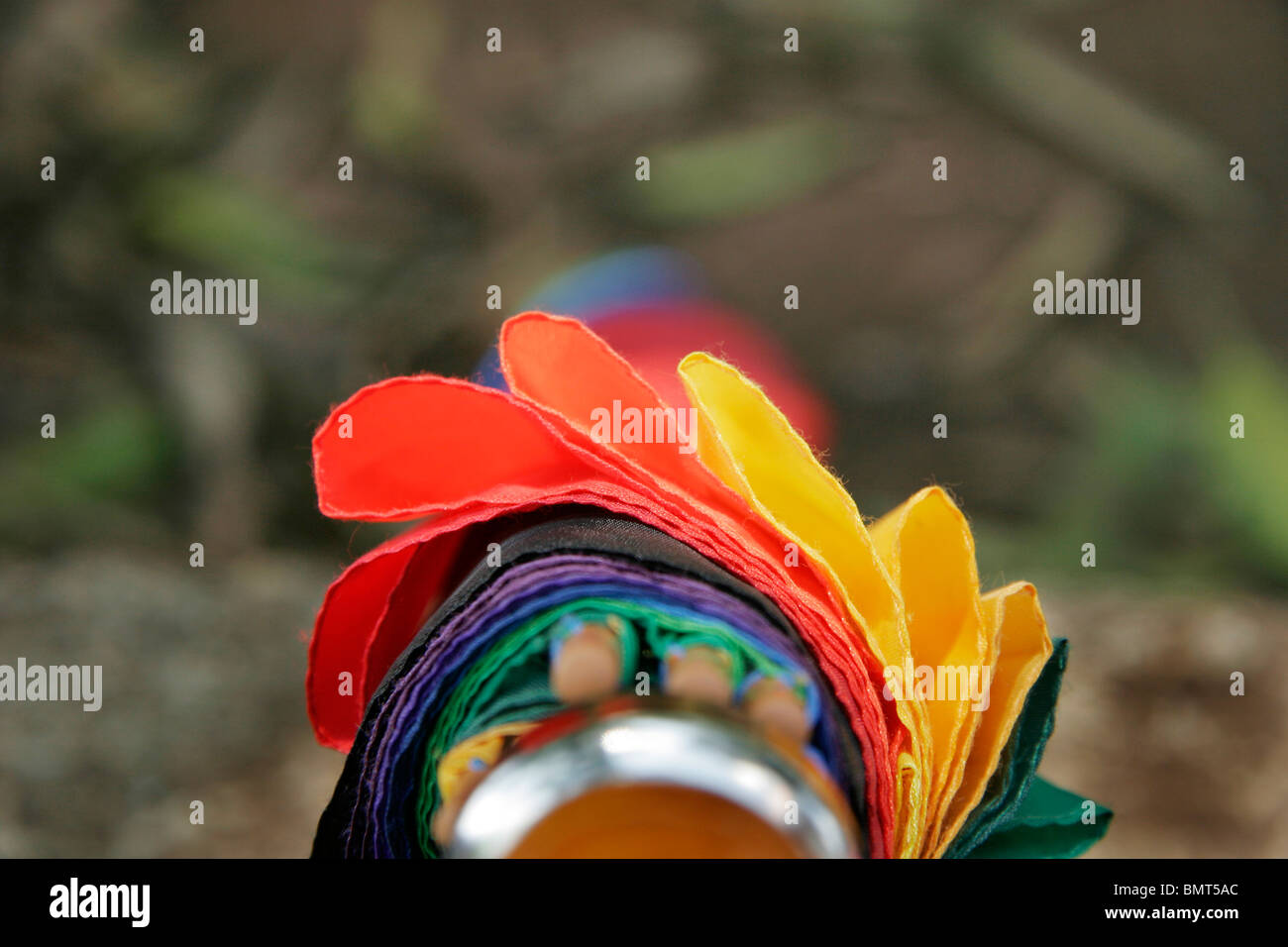 Abstract in form of various colors on folded umbrella - Stock Image